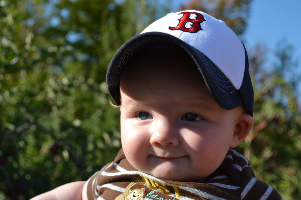 Smiling baby boy in the fall sun
