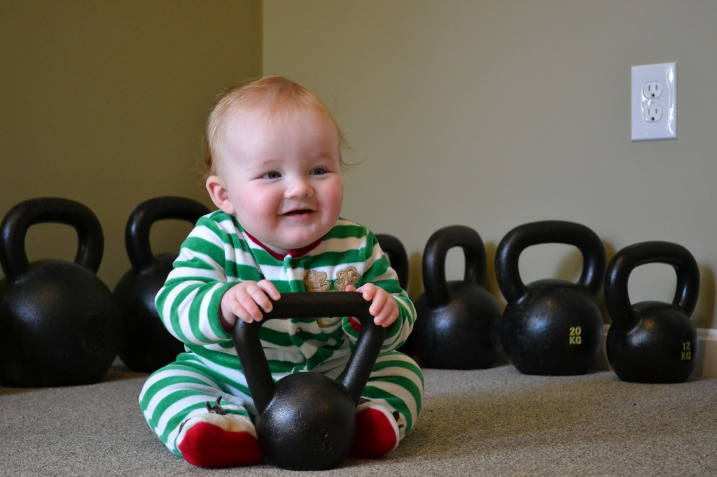 baby with kettlebell