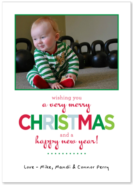 Christmas Card of Baby Surrounded by Kettlebells