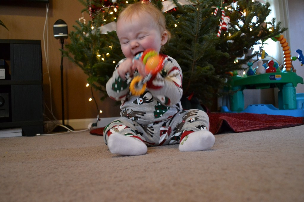 Baby playing with rattle on first Christmas
