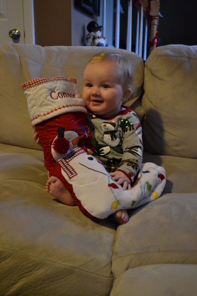 Baby on Christmas with his stocking