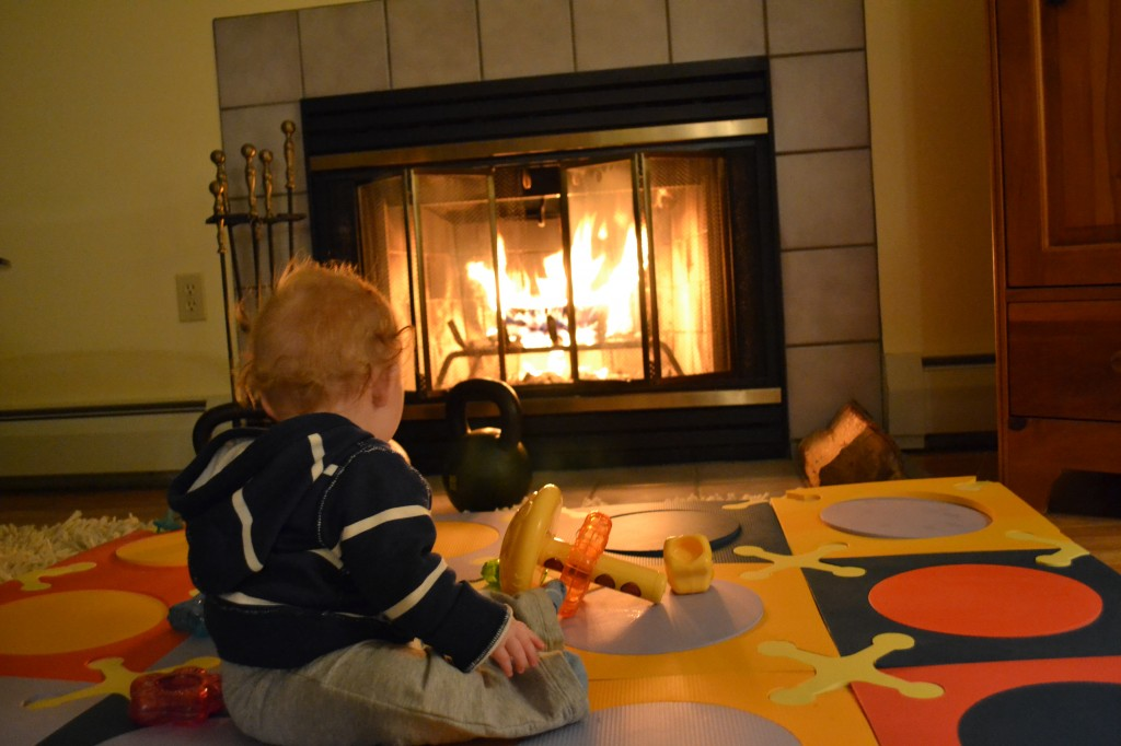 Baby sitting in front of the fire