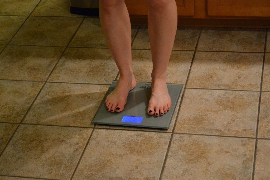 Woman Weighing Self