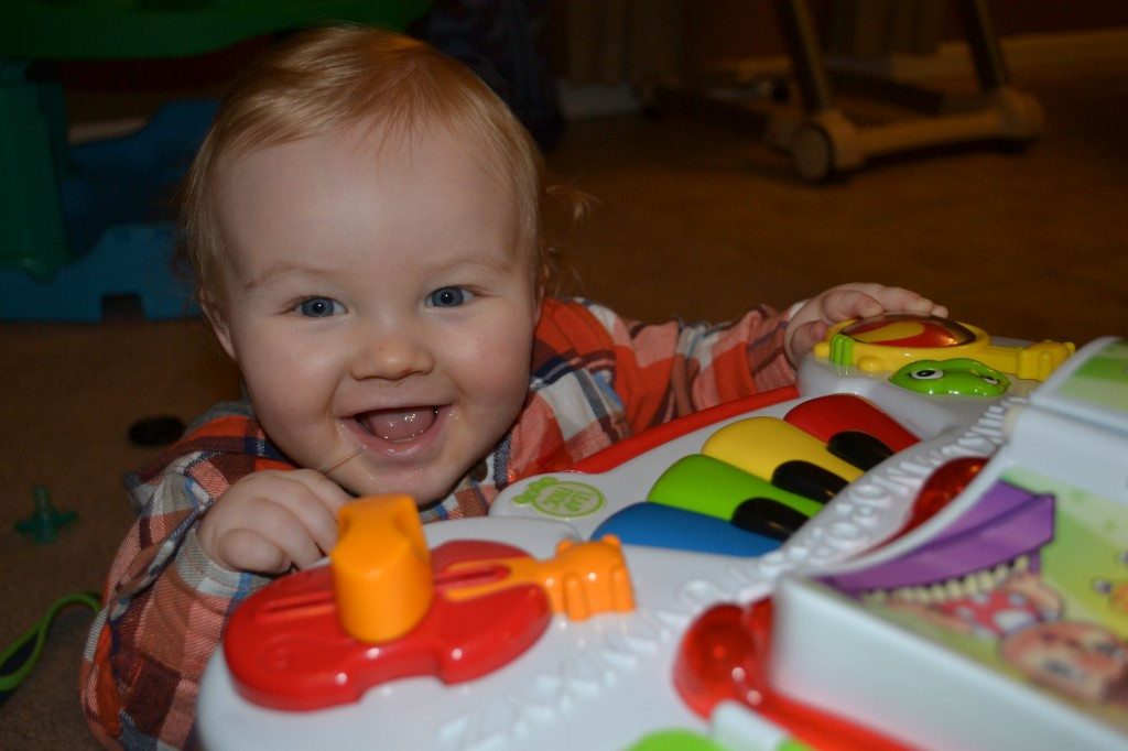 Baby Boy Playing With Learning Table