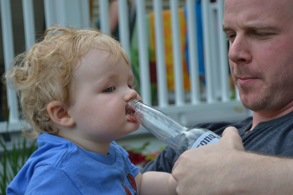 Beer Bottle in Baby's Mouth