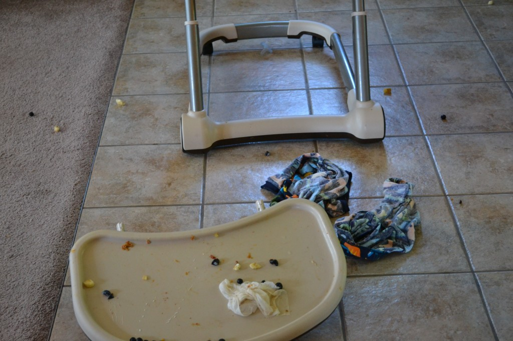 Cleaning High Chair After Breakfast