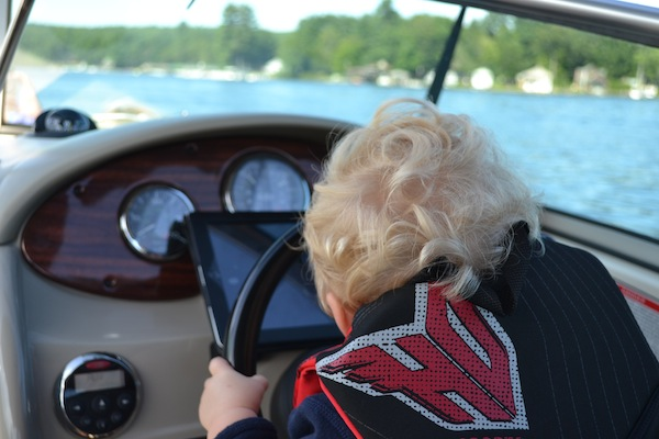 Baby Driving a Boat in NH