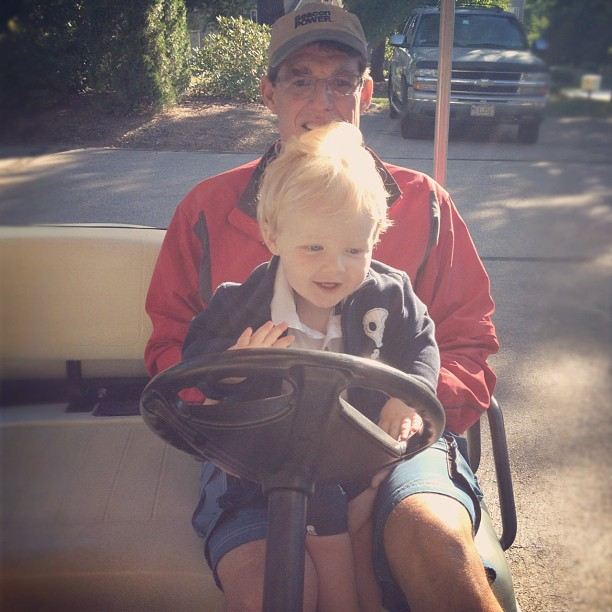 Baby Boy on Golf Cart with Grampy