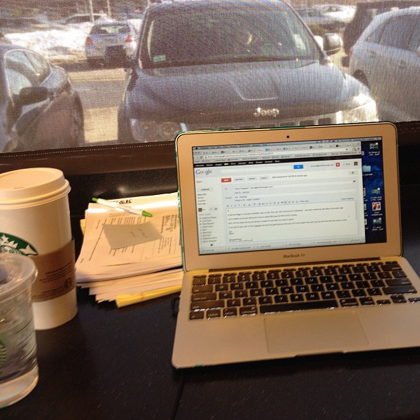 Working Mom Catching Up on Work at Starbucks