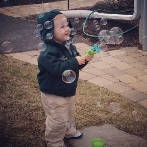 Two Year Old with Bubbles Outside